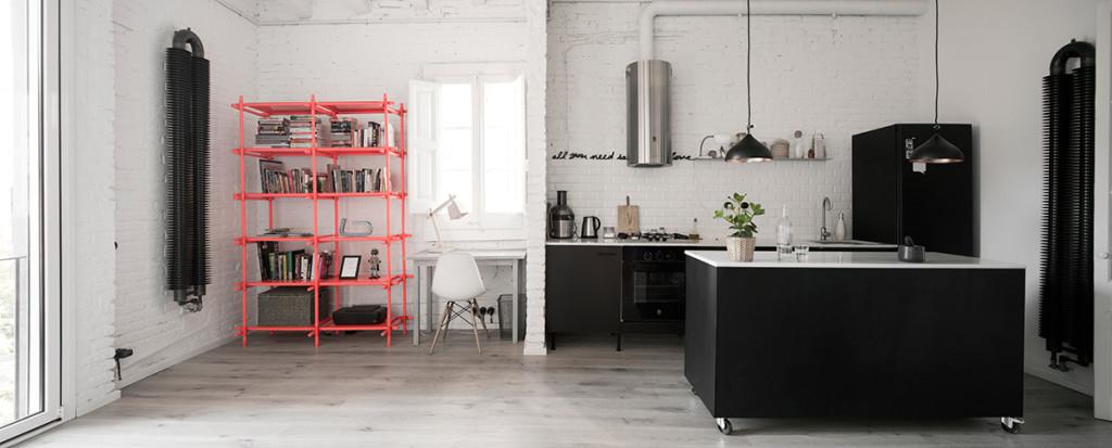 white brick barcelona loft - black kitchen