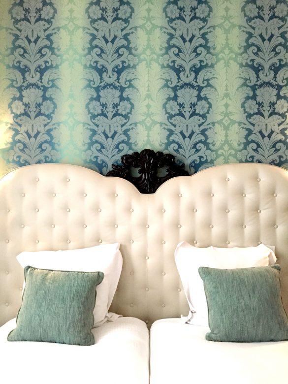 design hotel in Paris, le petit paris, boutique hotel Paris, , capitonné headboard, turquoise wallpaper
