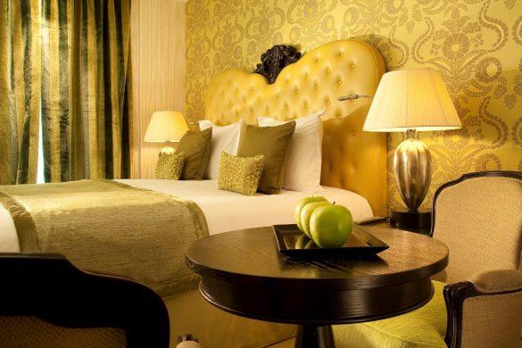 design hotel in Paris, le petit paris, boutique hotel Paris, hotel room design, yellow bedroom, yellos wallpaper, capitonne headboard