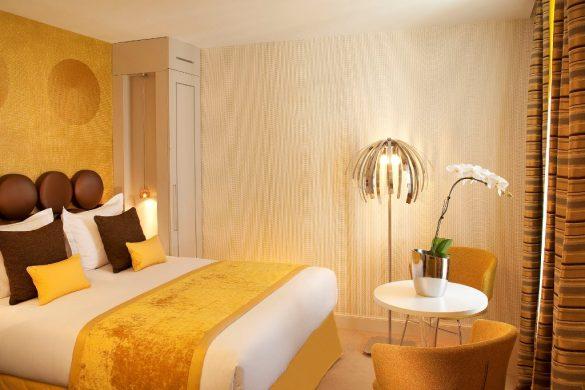 design hotel in Paris, le petit paris, boutique hotel Paris, hotel room design, yellow bedroom, seventies design