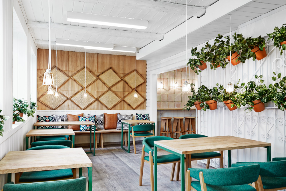 green chairs, restaurant green, restaurant design in oslo, restaurant design sweden, cool restaurant design , masquespacio, white green design, spanigh restaurant design, ikat decor, wall decor with pots, terracotta pots hanged,