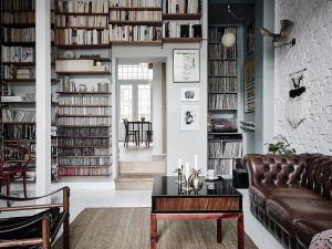 scandi home tour, unconventional scandi interior, italianbark interiordesign blog, green wall paint, floral wallpaper, william morris wallpaper, chesterfield leather sofa, floor to ceiling bookcase