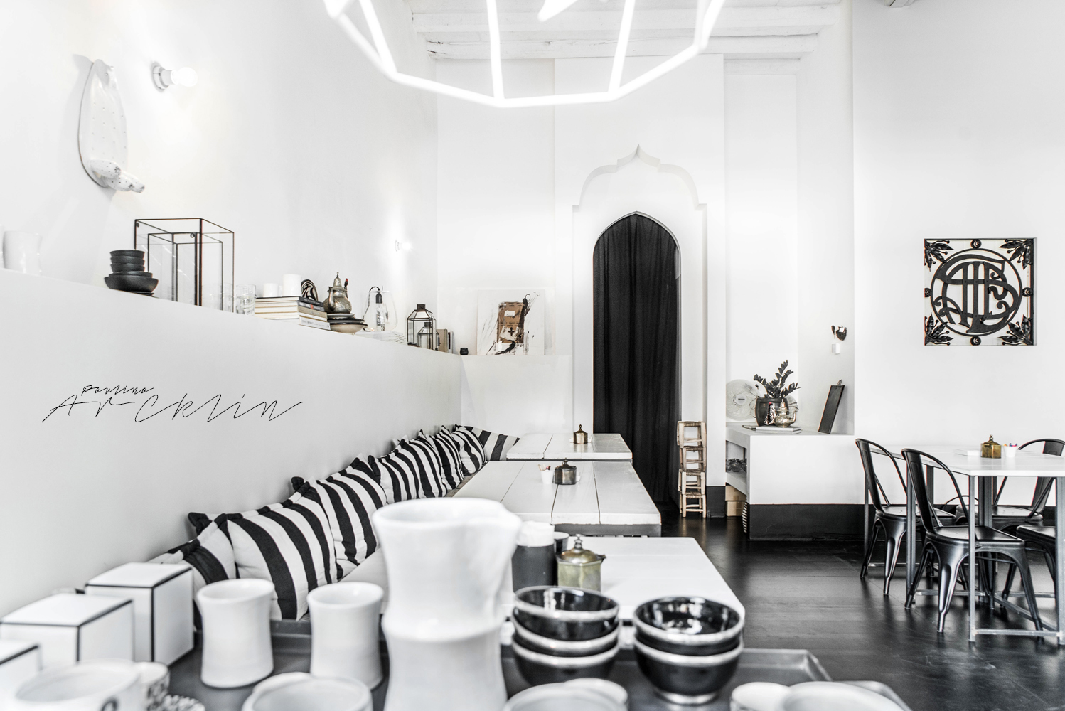 design restaurant in milan, italian interiors, italian interior design, italian design restaurant, paulina arcklin, riad food garden , black white restaurant design, ethnic chic, ethnic scandinavian, scandi boho, scandinavian style restaurant, tine k home, black white decor, black white striped cushions, black flooring