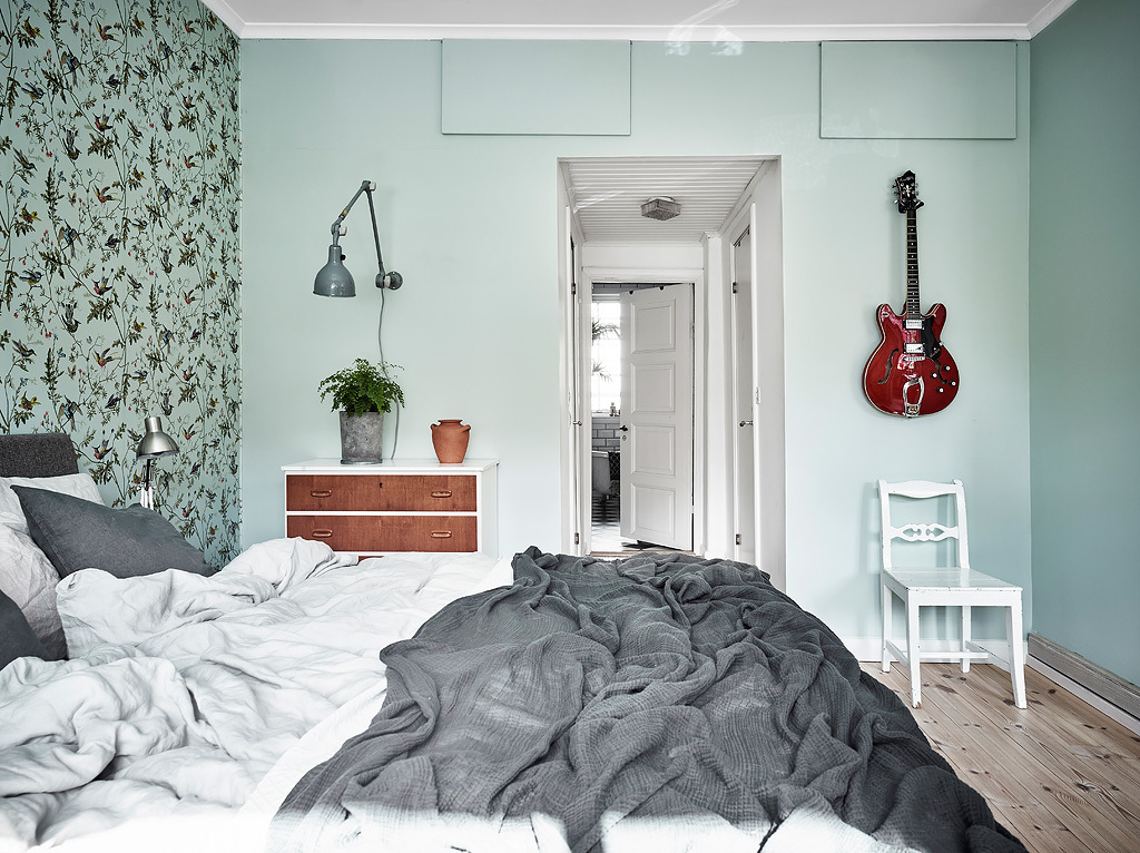 Colorful Scandinavian apartment with neutrals and mint interior