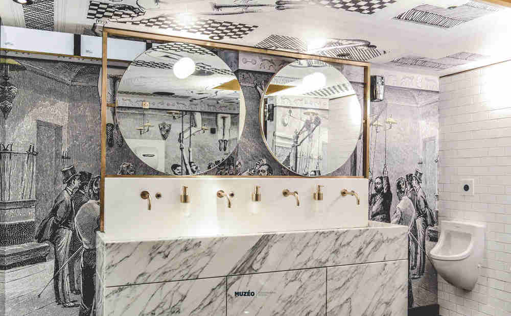 the result is a bespoke black white wallpaper covering all walls and ceiling specifically designed to recall the original gymnasium activities - Toilet Design Images